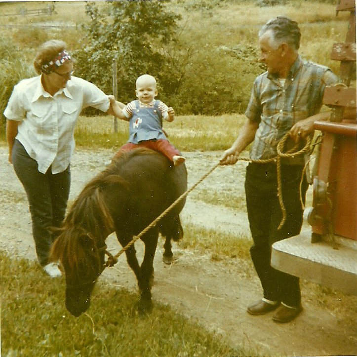 "Grandma, me, Grandpa, and ""Lady"".  Probably in '71"
